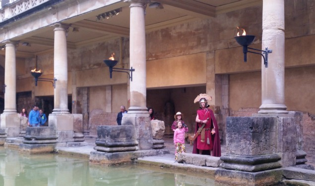 on the columns.My two daughter stand by the main bath with the Roman Centurion actor.The torches have been lit